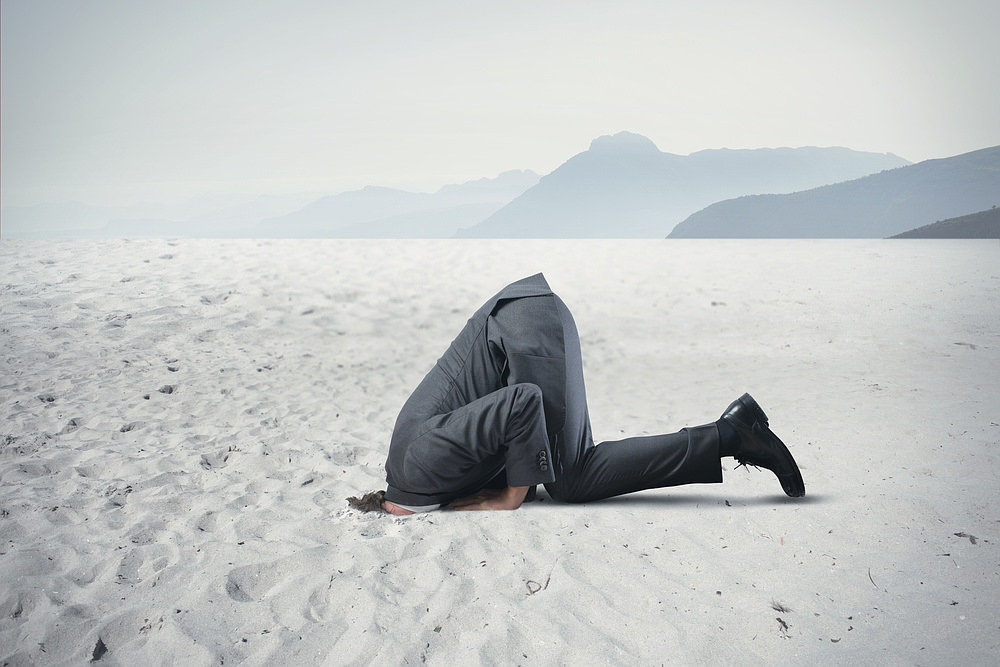 Ostrich-Effekt-Kopf-in-den-Sand